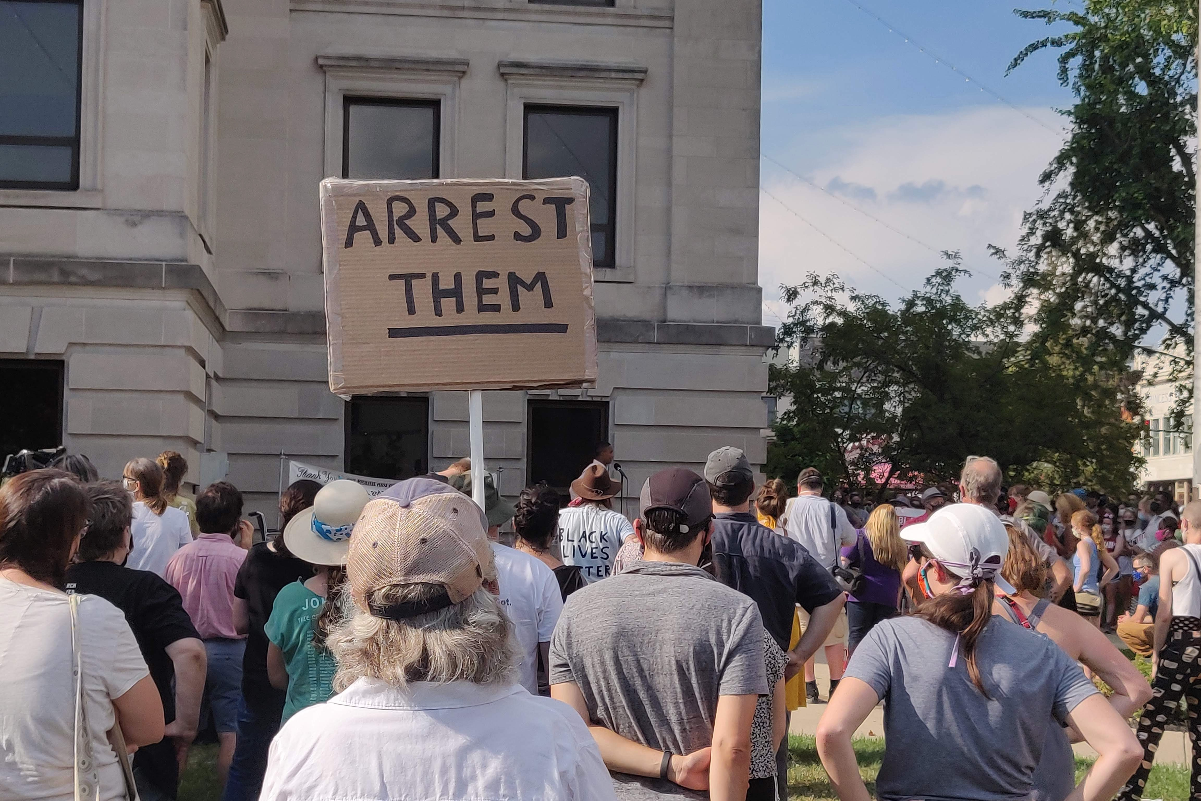 arrest them sign