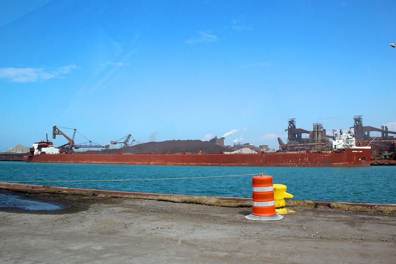 "A semi-automated ""laker"" ship, the Stewart Cort, offloads iron ore at the steel-maker ArcelorMittal across from the Port of Indiana-Burns Harbor."