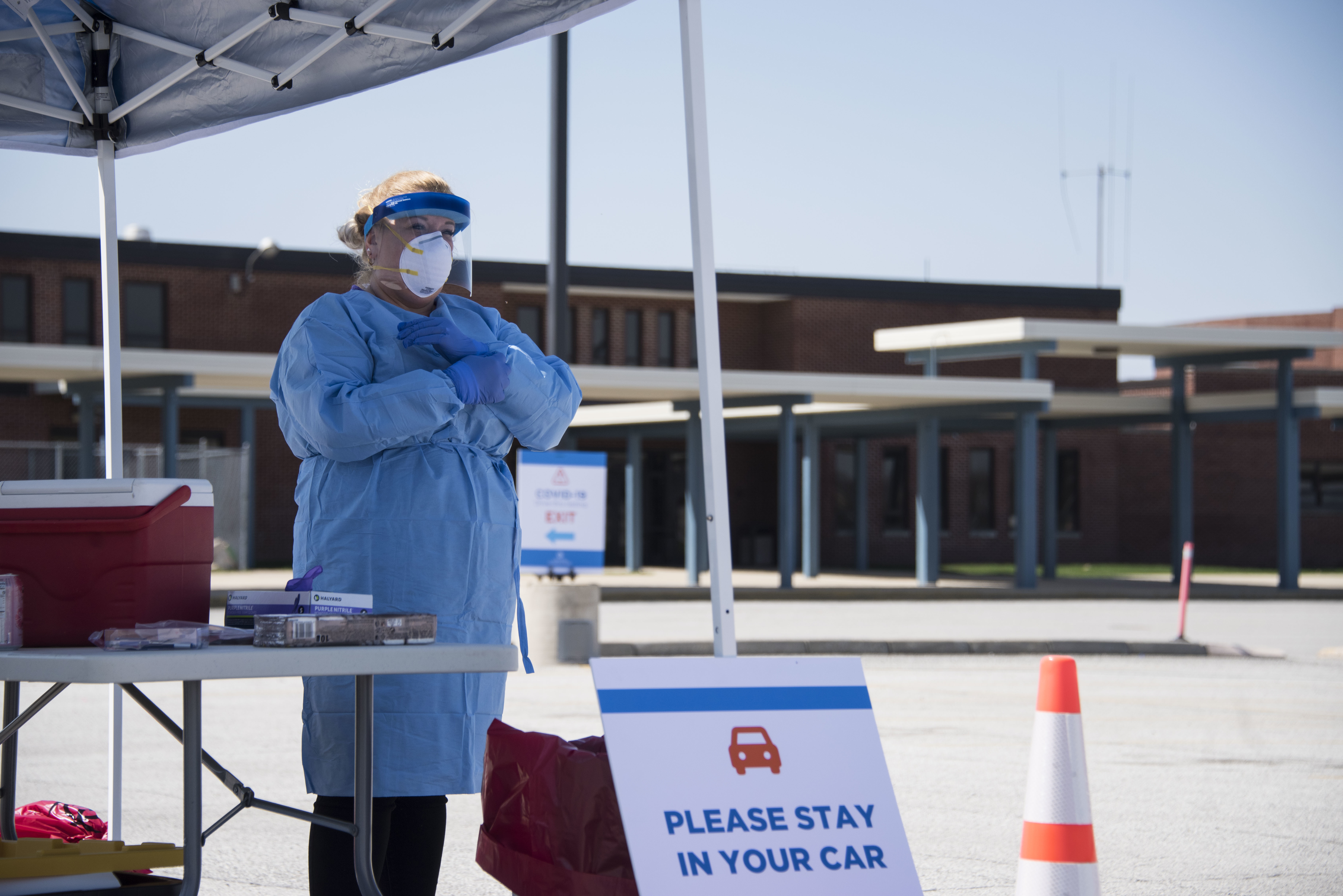An Indiana State Department of Health nurse participates in a drive-thru COVID-19 testing site at Merrillville High School, Merrillville, Indiana on April 8, 2020.