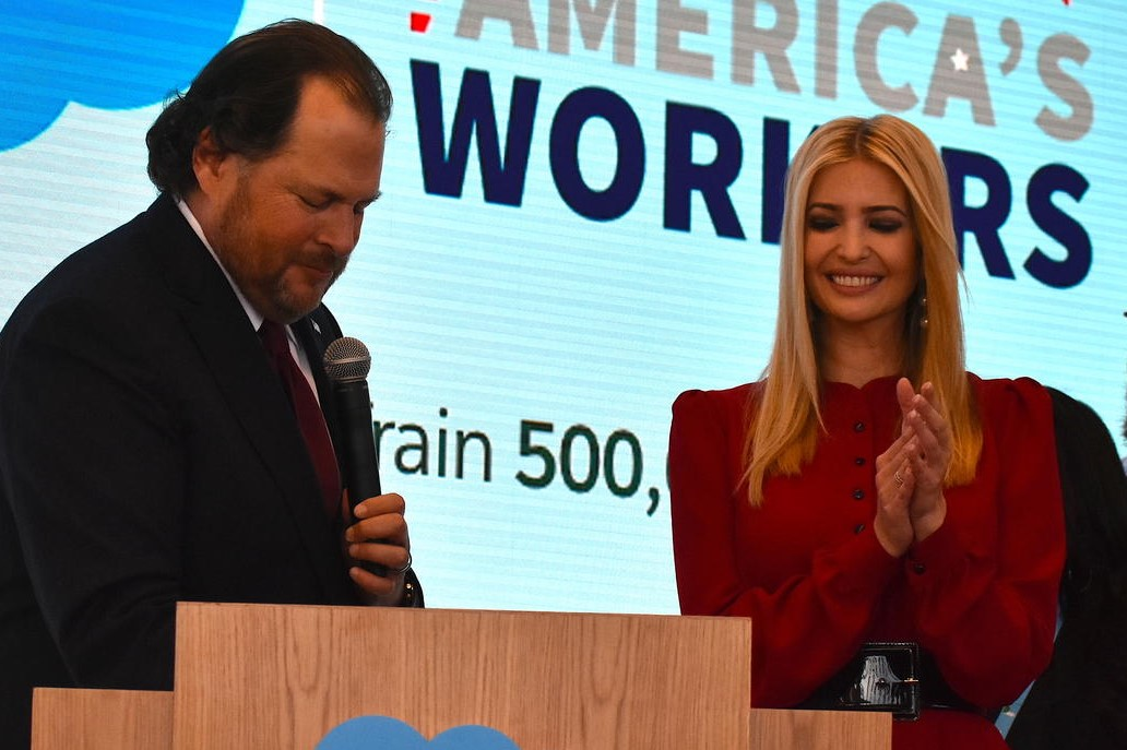 "Salesforce Chairman Marc Benioff signs President Trump's ""Pledge to America's Workers"" alongside Ivanka Trump."