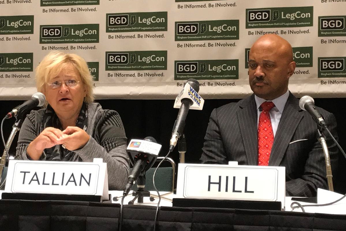 Sen. Karen Tallian (D-Ogden Dunes) next to incumbent Republican Attorney General Curtis Hill at a 2017 legislative conference.