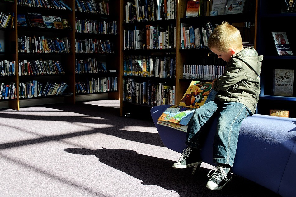 A child reads in a library.