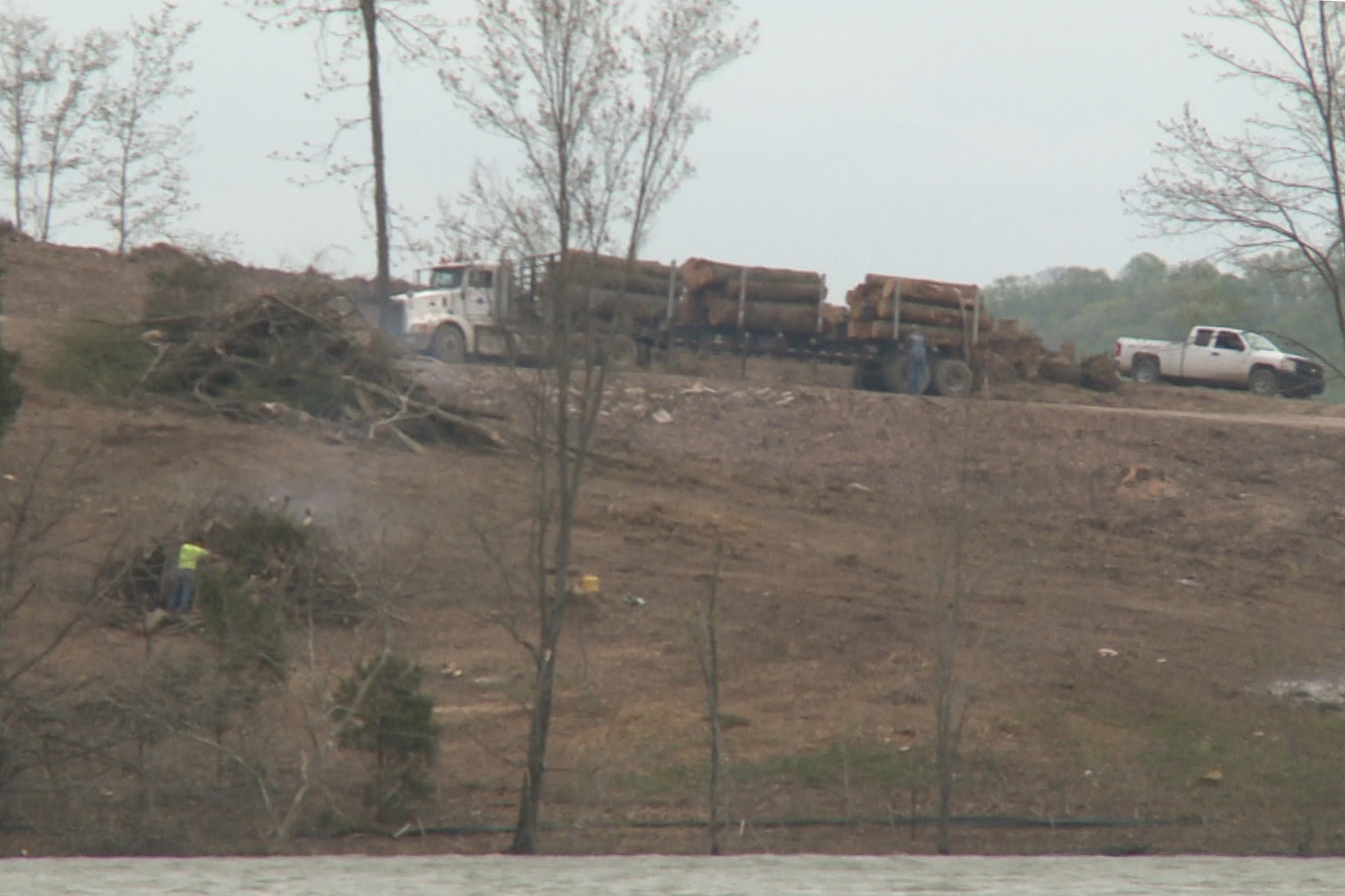 Logging trucks at Huff property
