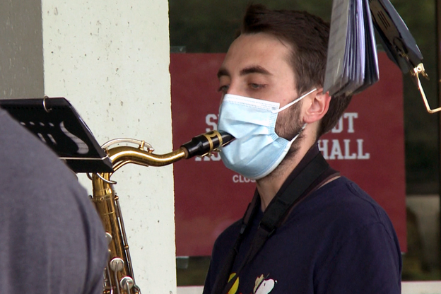 Marching Hundred member wears mask with slit