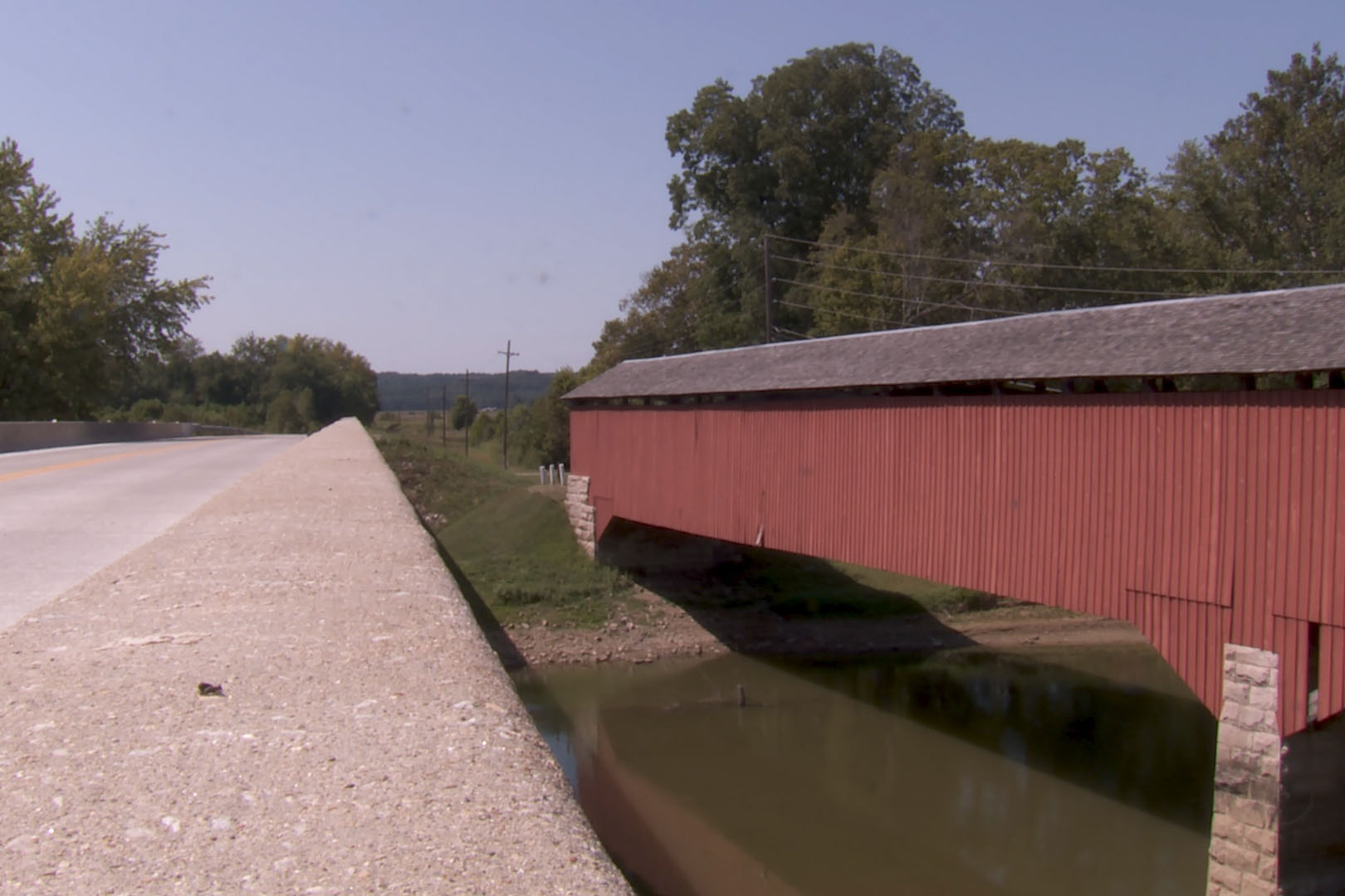 Jackson County Medora Covered Bridge runs parallel with St. Road 235 and crosses over The East Fork White River