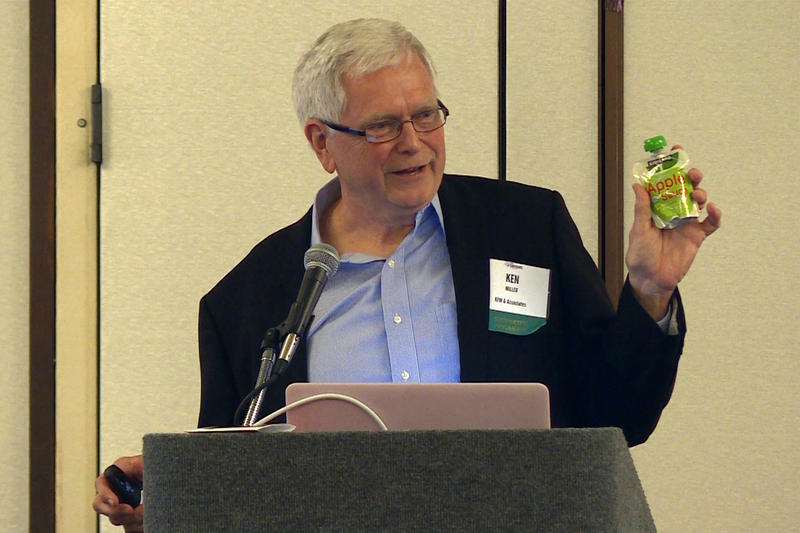 Ken Miller of KFM & Associates holds up a baby food pouch.