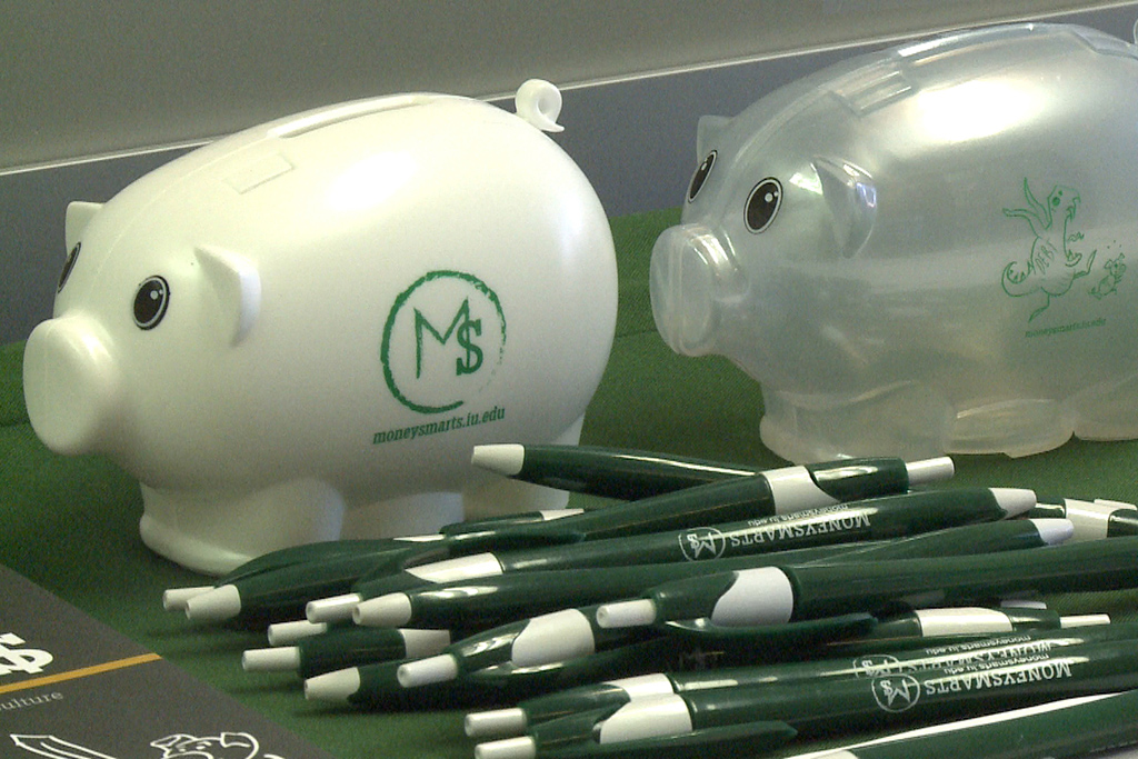 Photo of MoneySmart piggy bank and pens