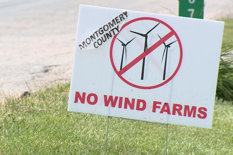 A sign advocating against wind turbines.