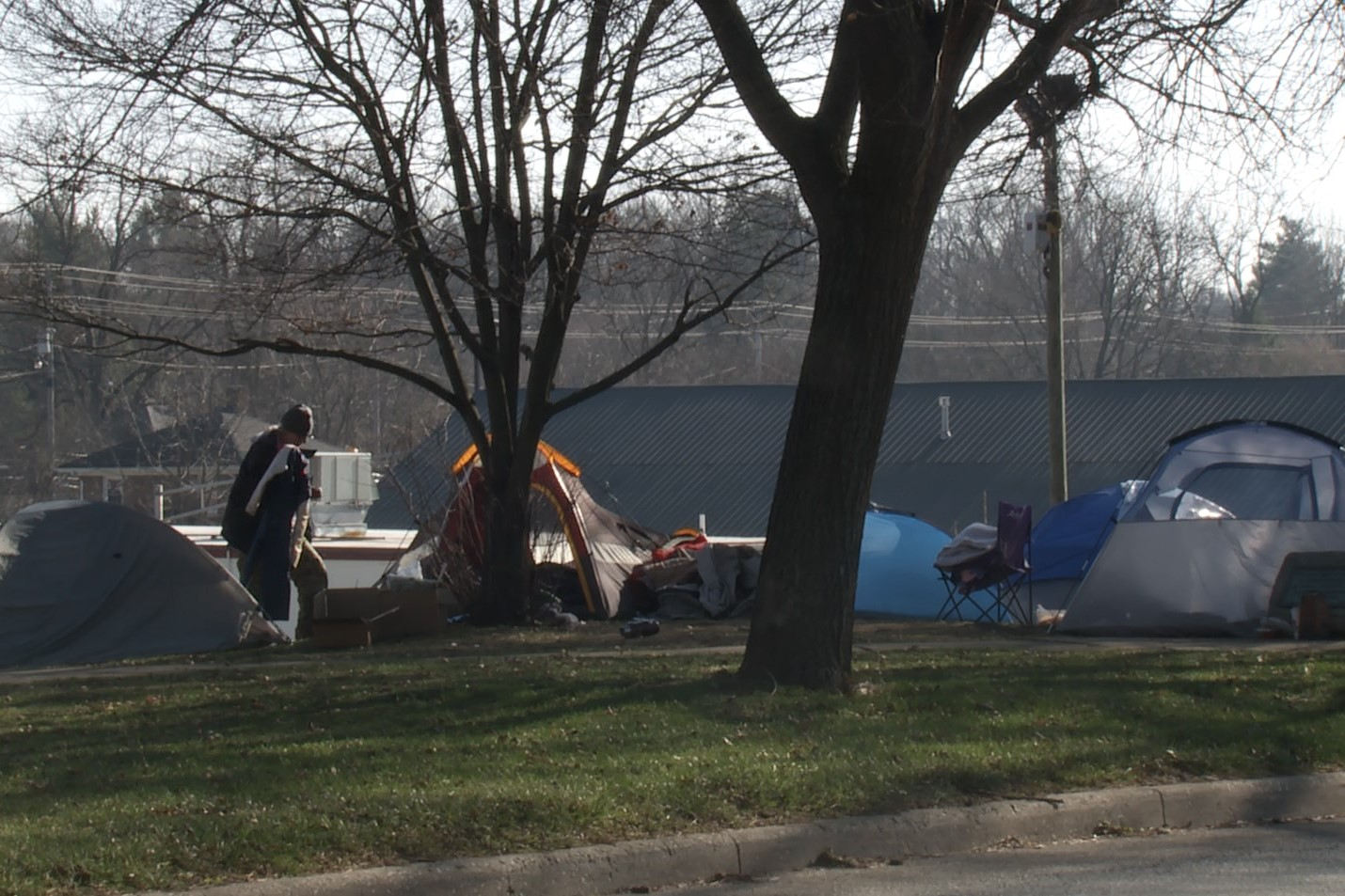 A photo of tents lined along College Avenue on the westside of Seminary Park.