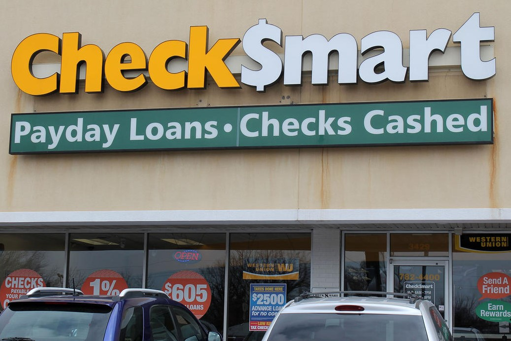 An exterior view of a Check Smart storefront, a payday lending company.