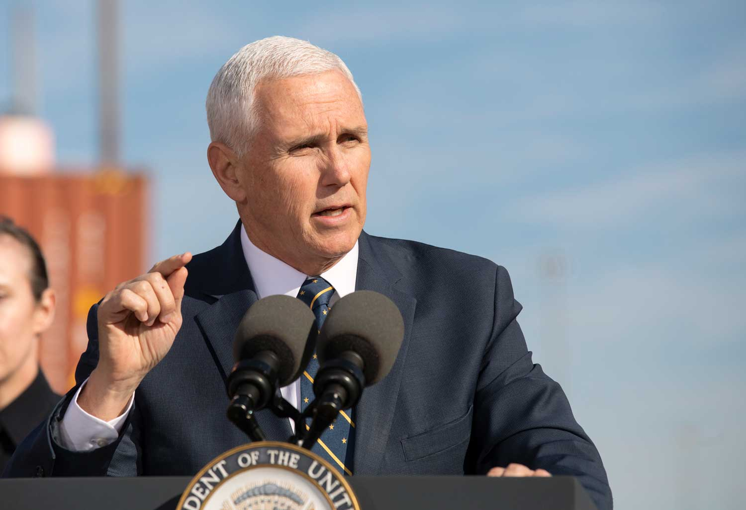 Vice president mike pence speaks at a podium in 2019