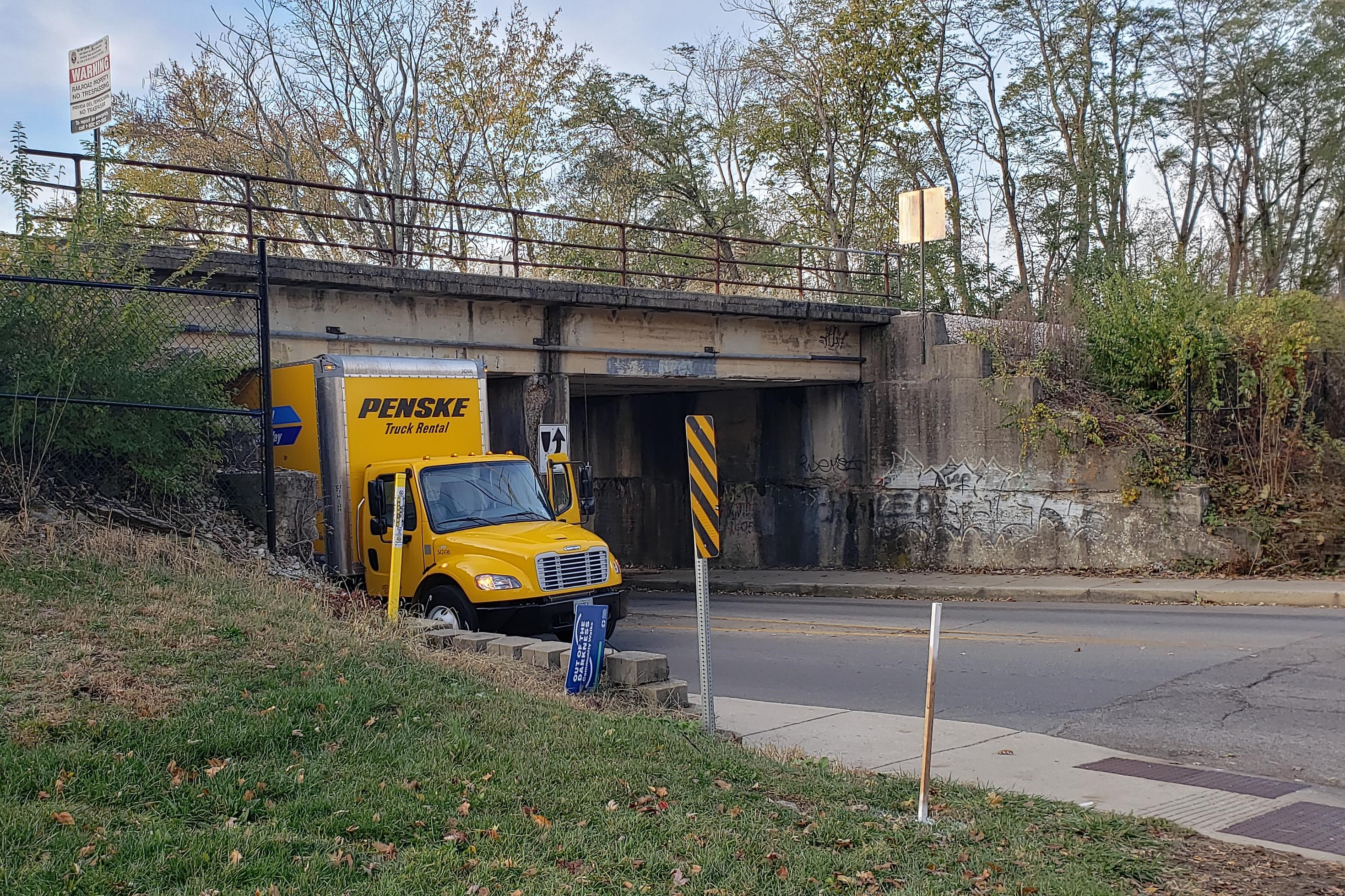 A Penske rental truck stuck under the Indiana Ave. railway bridge. Nov. 4, 2019.