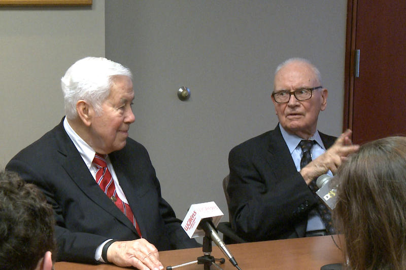 Richard Lugar and Lee Hamilton sit at a table.