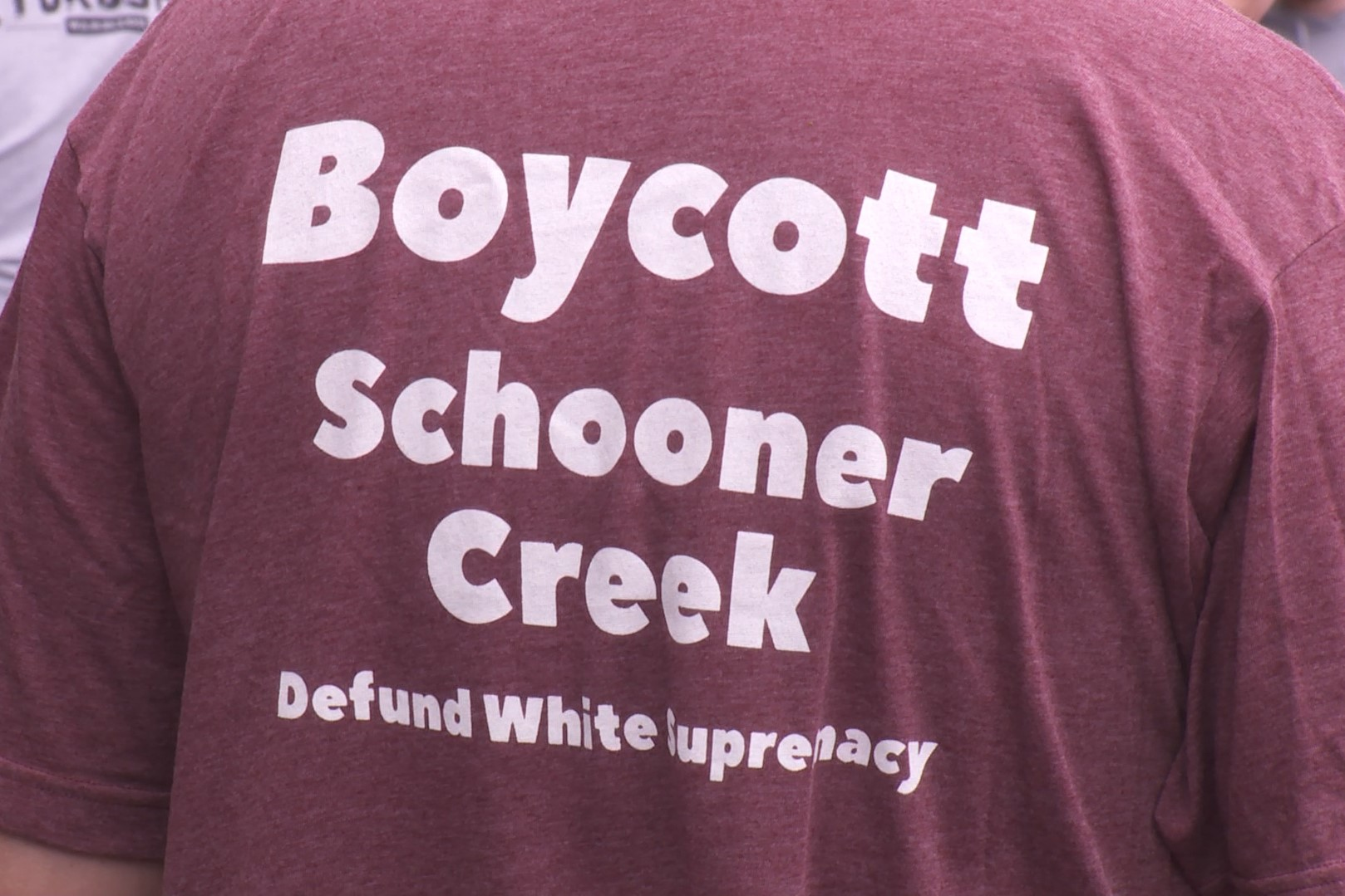 The back of an anti-Schooner Creek Farm protest t-shirt.