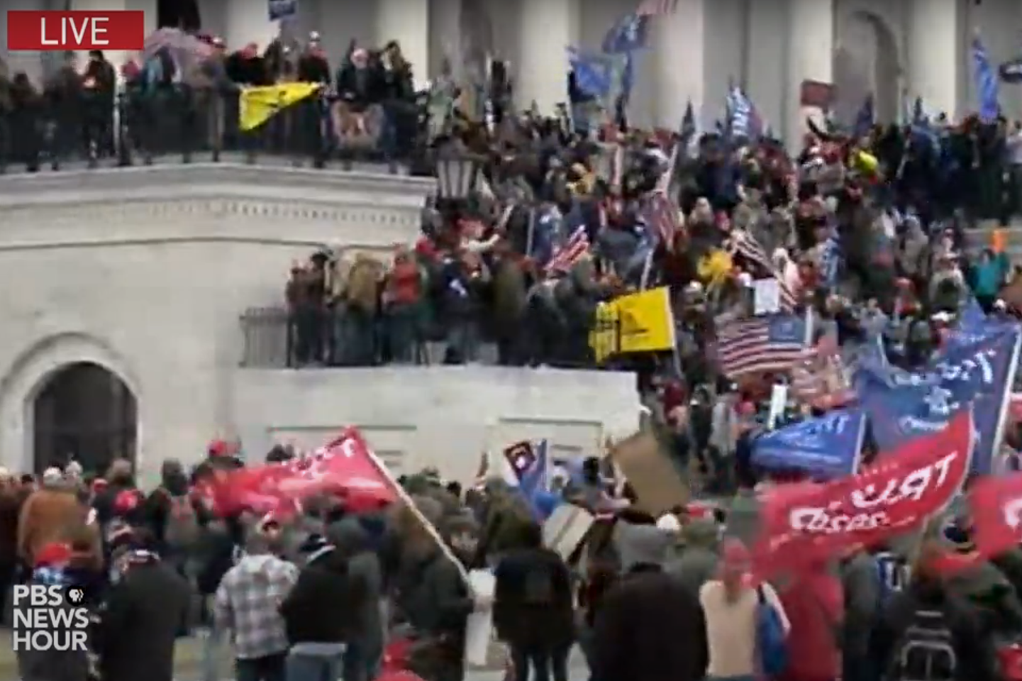A screenshot of PBS Newshour coverage of the protesting at the U.S. Capitol, Jan. 6 2021.
