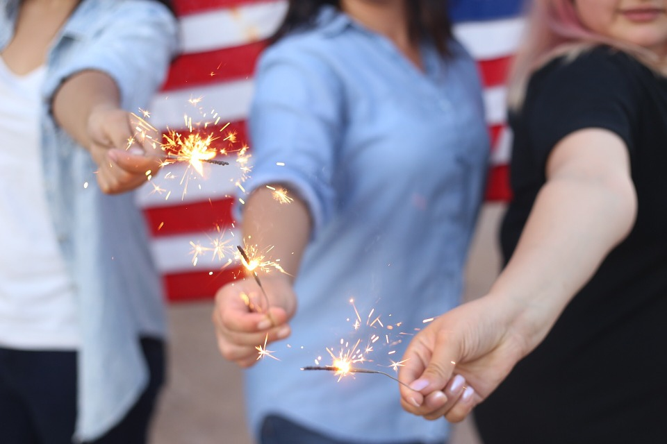 Stock image of people holding sparklers.