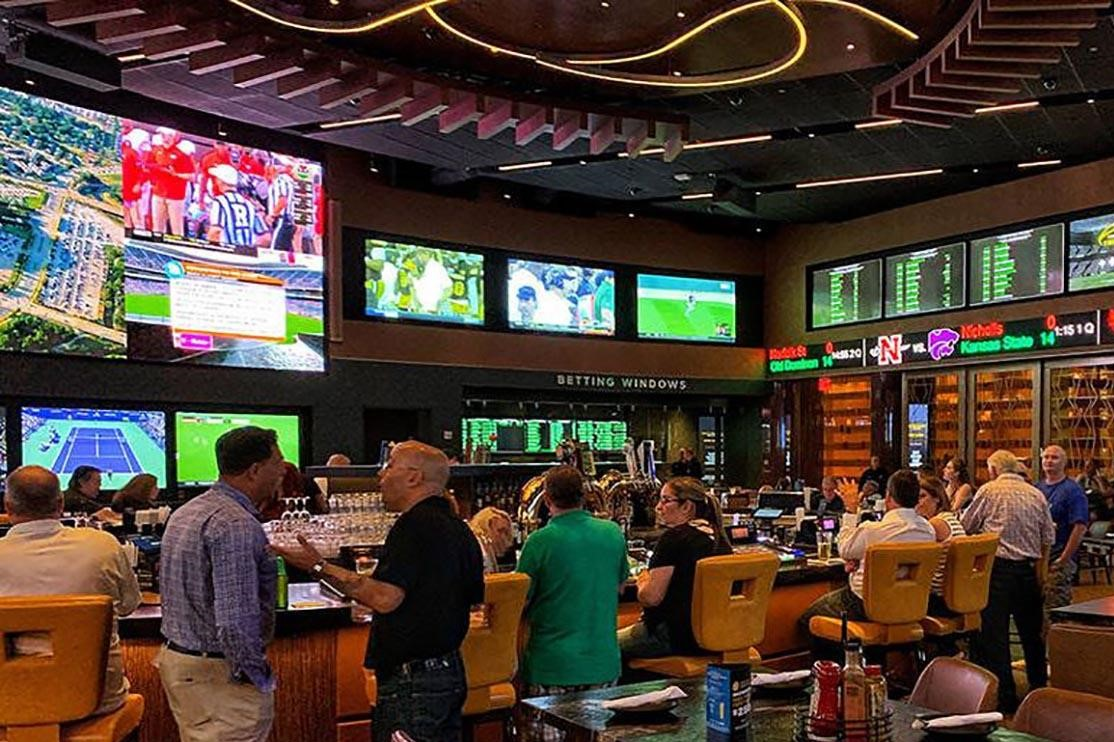 A generic photo of people at a casino (gambling, betting, sports betting)