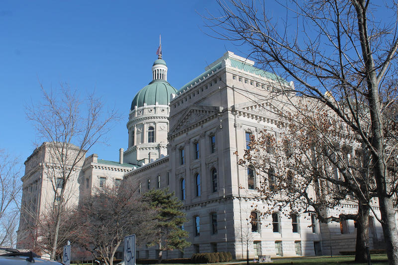 Indiana statehouse in spring with a blue sky