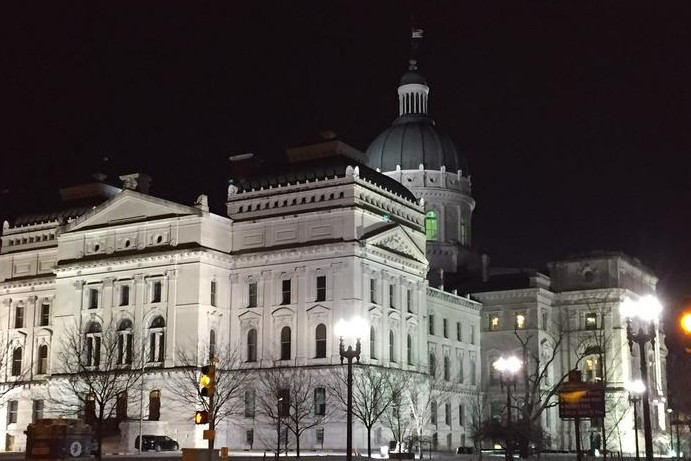 An exterior view of the Indiana Statehouse at night.