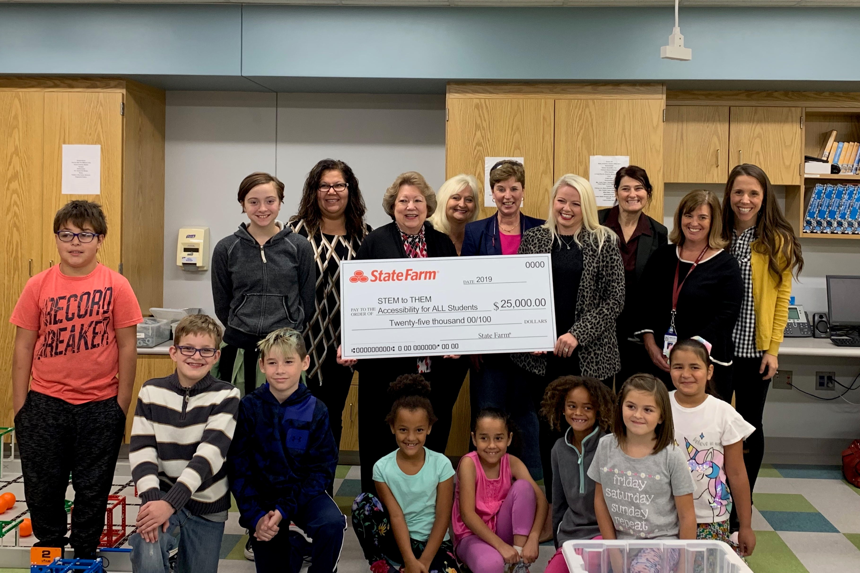 Participants in the STEM to THEM program celebrate the $25k grant at Grandview Elementary School in Bloomington.
