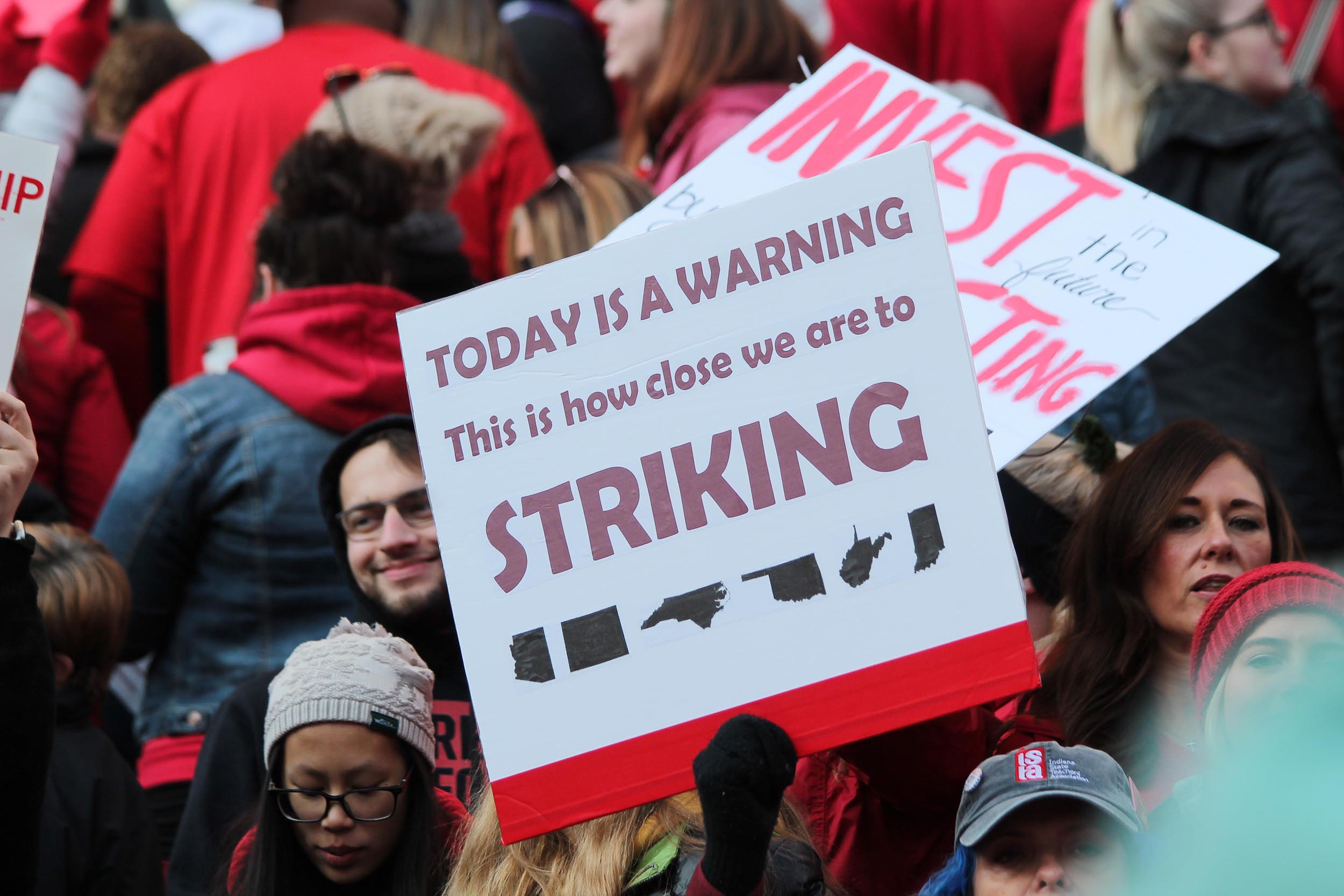 Many of the teachers at Nov. 2019's Red For Ed rally held signs, including this one, referencing recent teacher strikes across the country.
