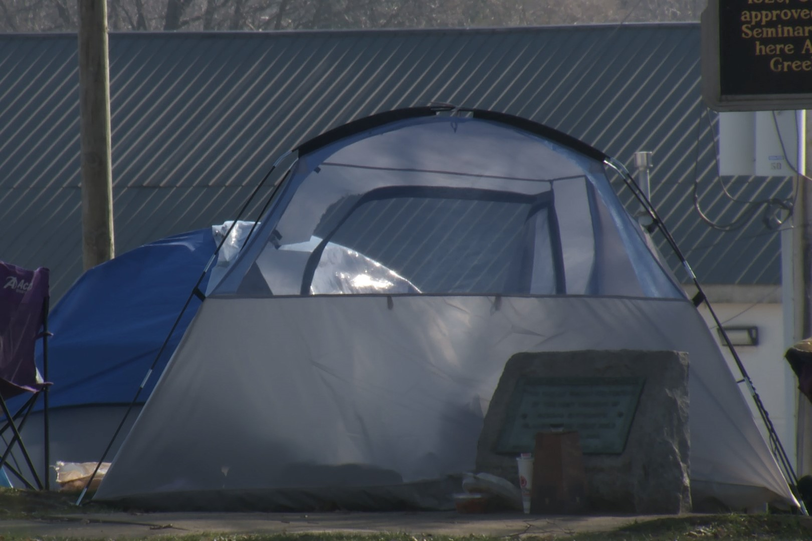 A photo of a tent set up in Bloomington's Seminary Park.