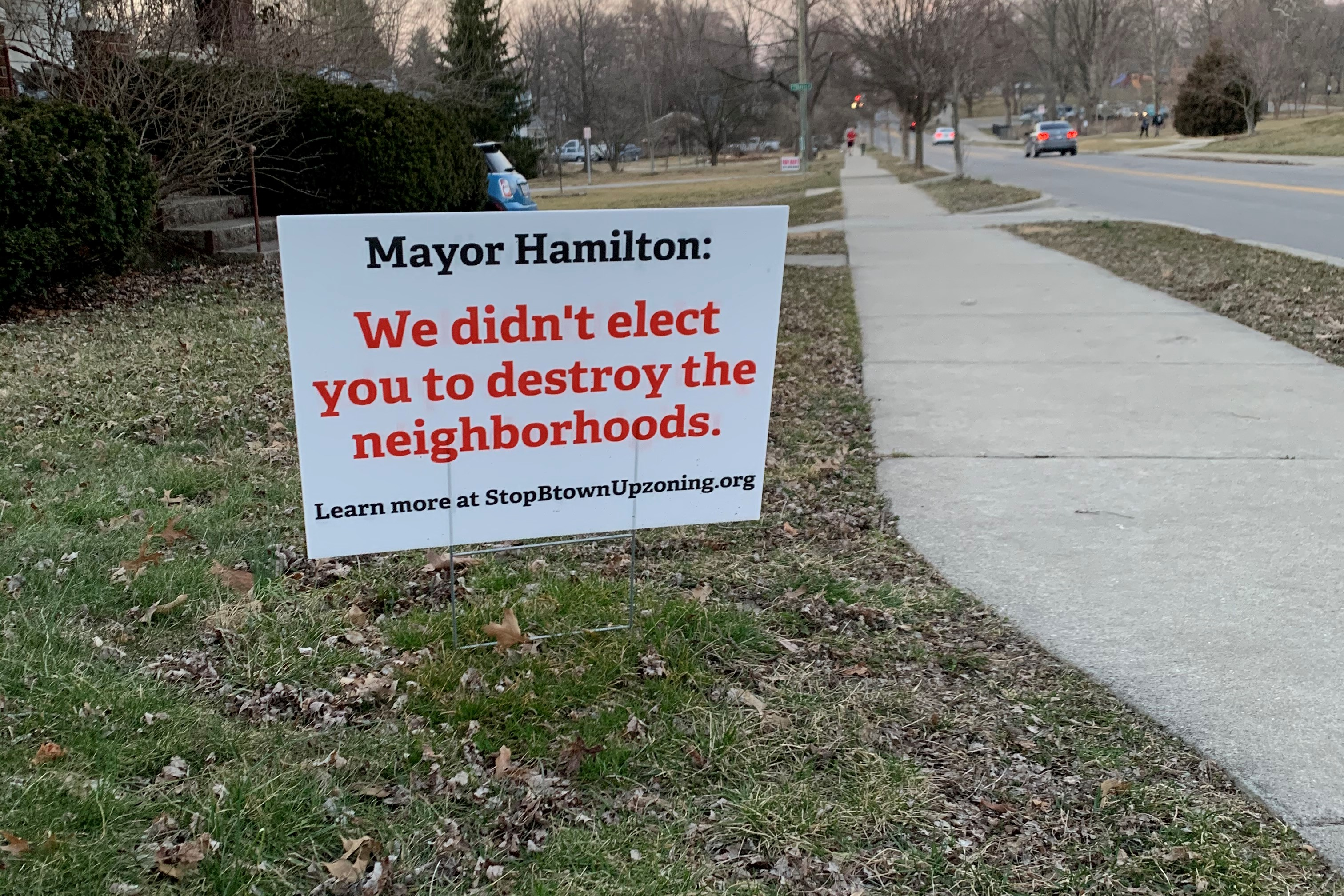 "A photo of a sign that says ""Mayor Hamilton we didn't elect you to destroy our neighborhoods."""