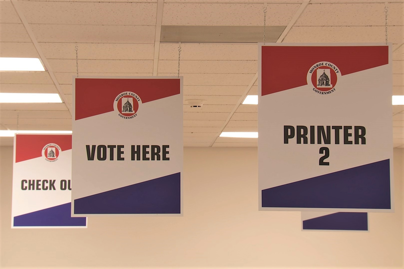 "Signs at a polling location that say ""vote here"" during the 2019 Monroe County municipal elections."