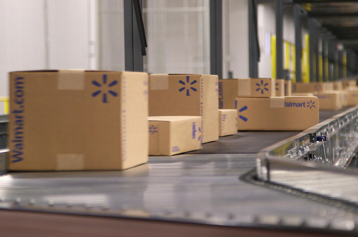Walmart e-commerce fulfillment center boxes being shipped.