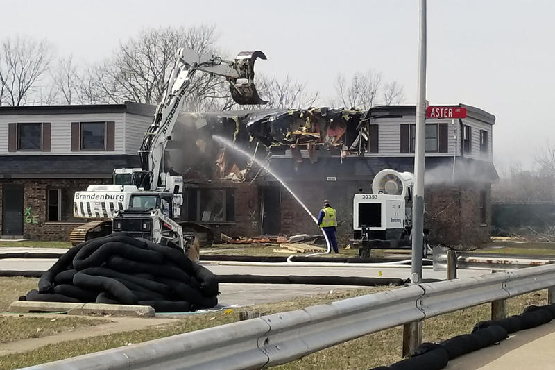 Crews tear down part of the West Calumet Housing Complex on April 2, 2018.