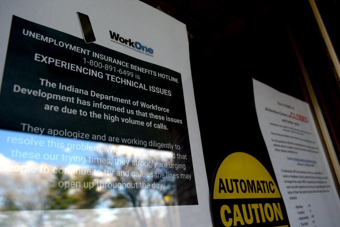 A sign informs visitors that while WorkOne employment offices are closed, the Department of Workforce Development is experiencing technical issues due to high call volumes.