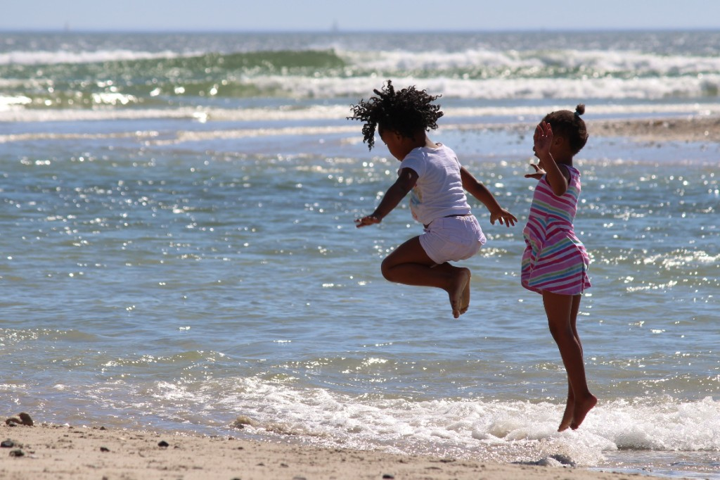 Girls jumping at the seashore