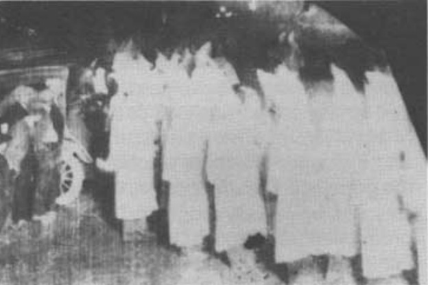 white-robed KKK members in Indiana