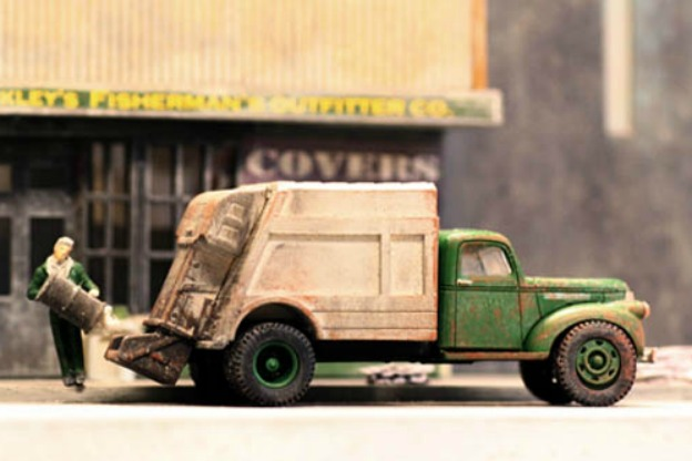 model of trash truck and sanitation worker