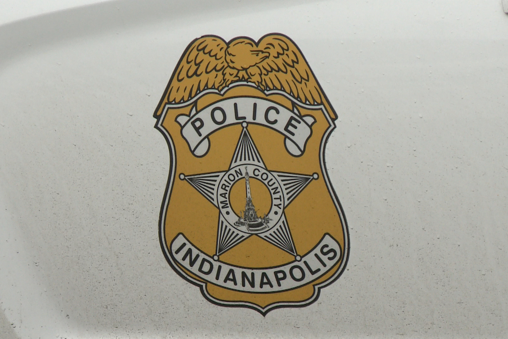 IMPD-shield-logo-on-car-close-up.jpg