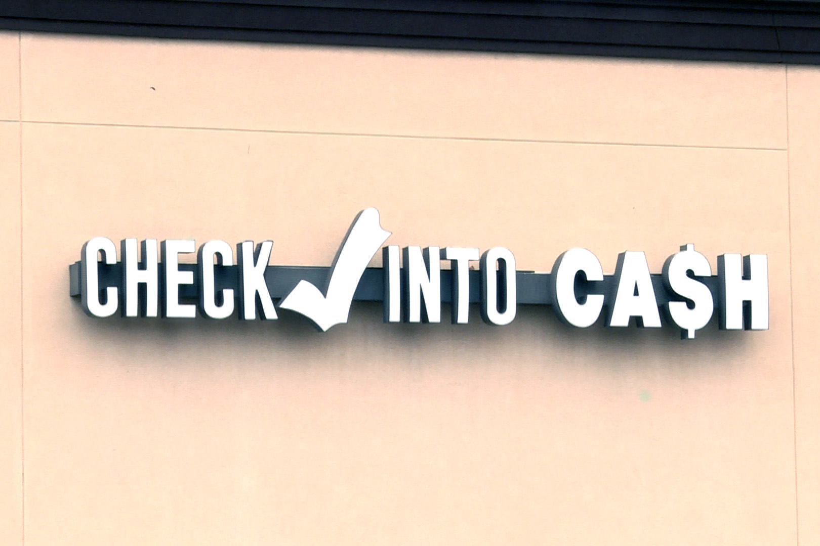 check into cash payday loan sign