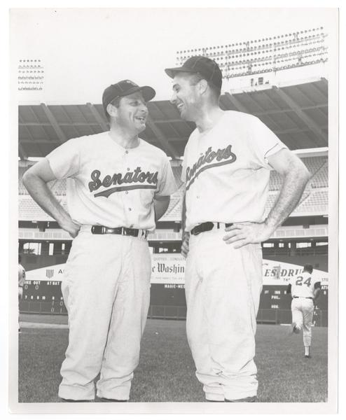birch bayh and lee hamilton stand on a baseball field in baseball uniforms