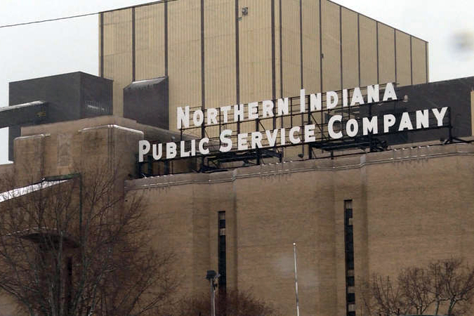 A brick building with a sign that says northern indiana public service company