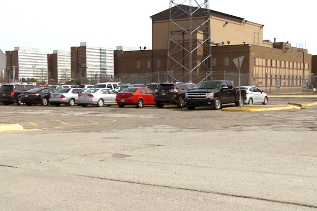 Parking lots surround the north and west sides of the current jail site.