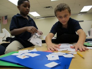 Second graders in teacher Courtney McCollough's class play fraction games on the last day of summer school. An advanced curriculum