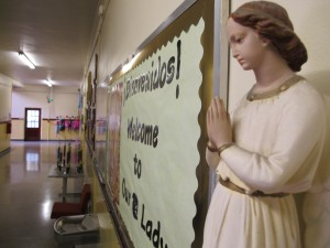 A 'Holy Hall Monitor' near the front entrance of Our Lady of Hungary Catholic school in South Bend.
