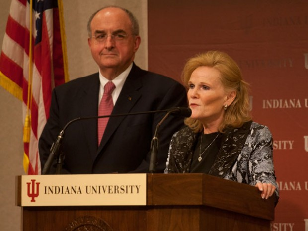 IU president Michael McRobbie looks on as Higher Education Commissioner Teresa Lubbers speaks during a press conference on Monday, October 24 in Indianapolis. McRobbie was announcing a 25 percent summer semester tuition discount for in-state undergraduate students.