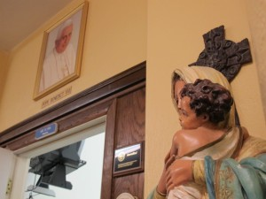 A picture of Pope Benedict XVI hangs in the hallway of St. Thomas Aquinas School in Indianapolis.