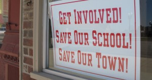 Signs like this one from Worthington are becoming more common in town across rural Indiana, where changes to the property tax code are forcing districts to consider school closure and consolidation.