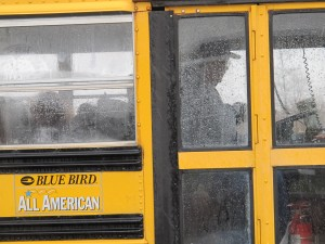 Mount Vernon Community School bus driver Dan Henighan waits to pick up students from an elementary school outside Fortville.