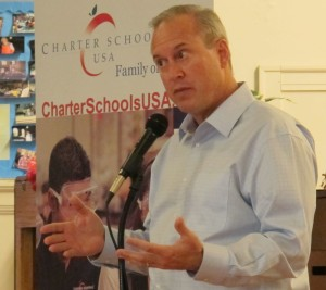 Charter Schools USA president and CEO Jon Hage speaks to a meeting in Indianapolis ahead as part of preparations for his company's takeover of Manual High School in July.