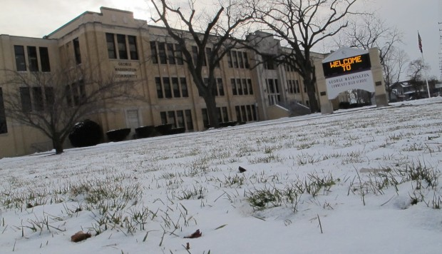 The first snowpack of the winter on the front lawn of Indianapolis' Washington High School.