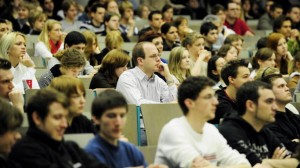 College students attend a lecture. Only three in ten undergraduate students in Indiana finish with a degree in four years.