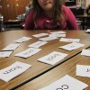 A Bloomington third grader takes part in a reading lesson about syllables.