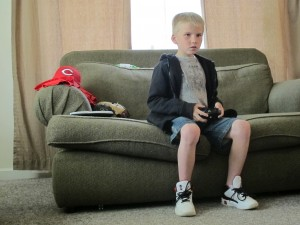 Ethan Brown, 9, plays a video game in his Franklin home. His teachers are beginning a remediation program to prepare him to retake the IREAD-3 in late June.